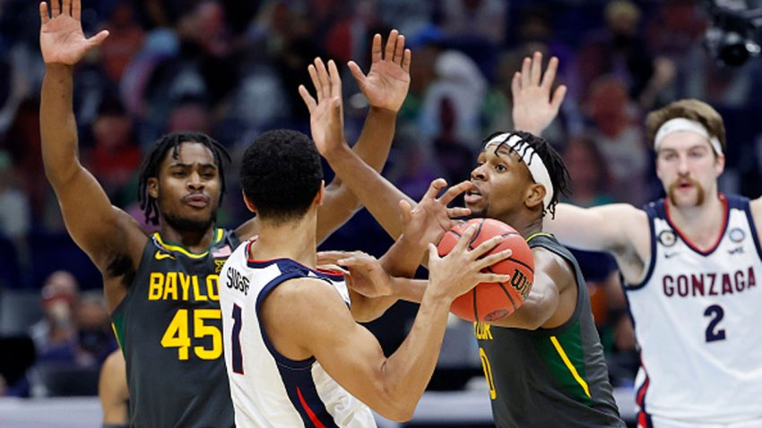 Jalen Suggs #1 of the Gonzaga Bulldogs looks to pass as Davion Mitchell #45 and Flo Thamba #0 of the Baylor Bears defend in the National Championship game of the 2021 NCAA Men's Basketball Tournament at Lucas Oil Stadium on April 5, 2021 in Indianapolis, Indiana.