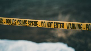 Police crime scene with a yellow 'caution' tape