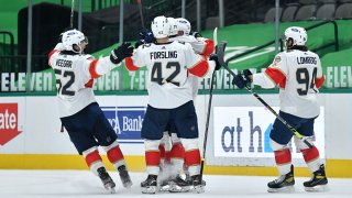 Gustav Forsling #42 and the Florida Panthers celebrate an overtime win against the Dallas Stars at the American Airlines Center on April 13, 2021 in Dallas, Texas.