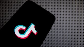 In this photo illustration TikTok logo is displayed on a smartphone screen in Athens, Greece on April 13, 2021