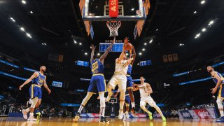 Luka Doncic #77 of the Dallas Mavericks looks to pass the ball during the game against the Golden State Warriors on April 27, 2021 at Chase Center in San Francisco, California.