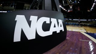 INDIANAPOLIS, INDIANA - MARCH 21: The NCAA logo is seen on the basket stanchion before the game between the Oral Roberts Golden Eagles and the Florida Gators in the second round game of the 2021 NCAA Men's Basketball Tournament at Indiana Farmers Coliseum on March 21, 2021 in Indianapolis, Indiana.