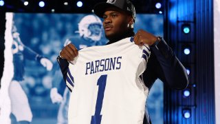 Micah Parsons poses onstage after being selected 12th by the Dallas Cowboys during round one of the 2021 NFL Draft at the Great Lakes Science Center on April 29, 2021 in Cleveland, Ohio.