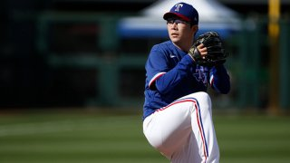 Pitcher Hyeon-jong Yang #68 of the Texas Rangers throws against the Los Angeles Dodgers during the eighth inning of the MLB spring training baseball game at Surprise Stadium on March 7, 2021 in Surprise, Arizona.