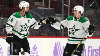 Jamie Benn #14 of the Dallas Stars celebrates his game winning overtime goal with Miro Heiskanen while playing the Detroit Red Wings at Little Caesars Arena on April 24, 2021 in Detroit, Michigan.