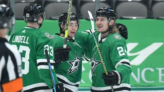 Esa Lindell #23, Jason Robertson #21 and Roope Hintz #24 of the Dallas Stars celebrate a goal against the Florida Panthers at the American Airlines Center on April 10, 2021 in Dallas, Texas.