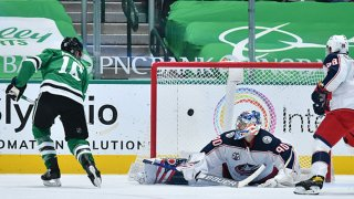Joe Pavelski #16 of the Dallas Stars flips in a goal against Elvis Merzlikins #90 of the Columbus Blue Jackets at the American Airlines Center on April 15, 2021 in Dallas, Texas.