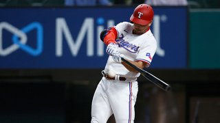 Nate Lowe #30 of the Texas Rangers hits a tow-run home run against the Toronto Blue Jays in the the bottom of the first inning at Globe Life Field on April 6, 2021 in Arlington, Texas.