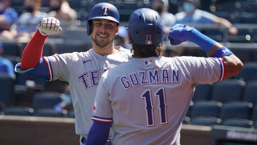 Nate Lowe #30 of the Texas Rangers celebrates his three-run home run with Ronald Guzman in the third inning against the Kansas City Royals at Kauffman Stadium on April 4, 2021 in Kansas City, Missouri.