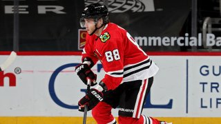 Patrick Kane #88 of the Chicago Blackhawks skates with the puck in the third period against the Dallas Stars at the United Center on April 6, 2021 in Chicago, Illinois.