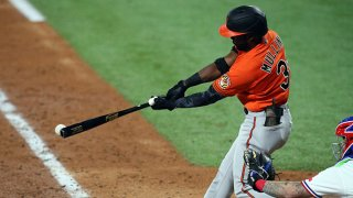 Cedric Mullins #31 of the Baltimore Orioles hits an RBI single in the seventh inning against the Texas Rangers during the MLB game at Globe Life Field on April 17, 2021 in Arlington, Texas.