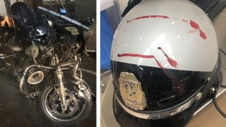 Picture of the police officers motorcycle and helmet after the collision
