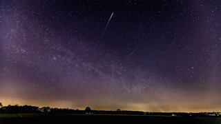 A meteor of the lyrids in the sky is seen on April 22, 2020 in Schermbeck, Germany.