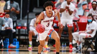Guard Micah Peavy #5 of the Texas Tech Red Raiders handles the ball during the first half of the college basketball game against the Kansas Jayhawks at United Supermarkets Arena on Dec. 17, 2020 in Lubbock, Texas.