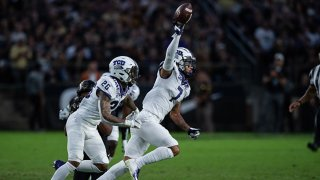 TCU Horned Frogs safety Trevon Moehrig (7) and TCU Horned Frogs safety Vernon Scott (26) celebrate a interception during the college football game between the Purdue Boilermakers and TCU Horned Frogs on Sept. 14, 2019, at Ross-Ade Stadium in West Lafayette, Indiana.