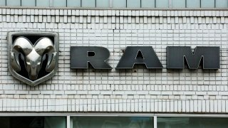 FILE - This Jan. 12, 2017, file photo shows the Ram logo at a Chrysler dealership in Pittsburgh. Fiat Chrysler said Friday, May 28, 2021 that it is recalling more than a half-million heavy-duty Ram trucks to fix a problem that can cause the wheels to fall off.