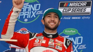 Chase Elliott, driver of the #9 Llumar Chevrolet, celebrates in victory lane after winning the NASCAR Cup Series EchoPark Texas Grand Prix at Circuit of The Americas on May 23, 2021 in Austin, Texas.
