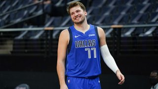 Luka Doncic #77 of the Dallas Mavericks smiles during the game against the Minnesota Timberwolves on May 16, 2021 at Target Center in Minneapolis, Minnesota.