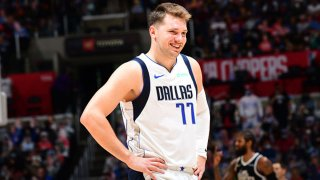 Luka Doncic #77 of the Dallas Mavericks smiles during Round 1, Game 1 of the the 2021 NBA Playoffs on May 22, 2021 at STAPLES Center in Los Angeles, California.