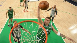 Luka Doncic #77 of the Dallas Mavericks dunks the ball during the game against the Washington Wizards on May 1, 2021 at the American Airlines Center in Dallas, Texas.