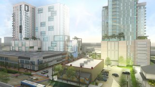 Downtown Dallas with High Rises underneath blue sky construction plan