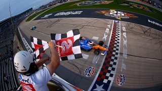 Scott Dixon of New Zealand, driver of the #9 PNC Bank Chip Ganassi Racing Honda, takes the checkered flag to win the NTT IndyCar Series Genesys 300 at Texas Motor Speedway on May 1, 2021 in Fort Worth, Texas.