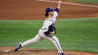 Austin Krob #39 of the TCU Horned Frogs throws against the Arkansas Razorbacks in the second inning during the 2021 State Farm College Baseball Showdown at Globe Life Field on Feb. 22, 2021 in Arlington, Texas.
