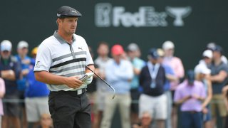 Bryson DeChambeau reads the 18th green during the third round of the Wells Fargo Championship at Quail Hollow Club on May 8, 2021 in Charlotte, North Carolina.
