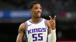 Delon Wright #55 of the Sacramento Kings puts two fingers up during the game against the Dallas Mavericks on May 2, 2021 at the American Airlines Center in Dallas, Texas.
