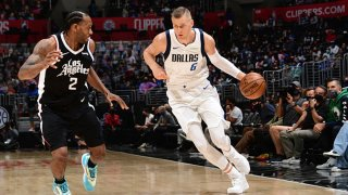 Kristaps Porzingis #6 of the Dallas Mavericks drives to the basket against the LA Clippers during Round 1, Game 1 of the the 2021 NBA Playoffs on May 22, 2021 at STAPLES Center in Los Angeles, California.