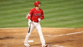 Shohei Ohtani #17 of the Los Angeles Angels watches his three run home run during the fourth inning against the Texas Rangers at Angel Stadium of Anaheim on May 25, 2021 in Anaheim, California.
