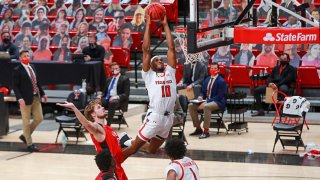 Forward Tyreek Smith #10 of the Texas Tech Red Raiders dunks the ball during the first half of the college basketball game against the Incarnate Word Cardinals at United Supermarkets Arena on Dec. 29, 2020 in Lubbock, Texas.