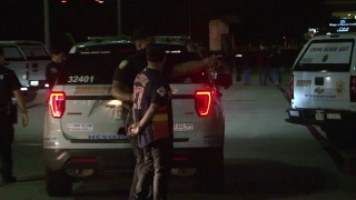 One woman died and several other people were injured when a driver struck a group of people in the parking lot of a suburban Houston restaurant following a reported fight early Thursday, police said.