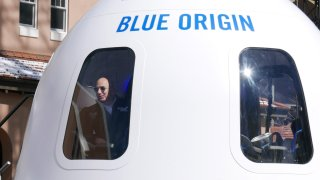Jeff Bezos looks out of space capsule.