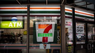 Signage is displayed outside a 7-Eleven store, a subsidiary of Seven & i Holdings Co., in Chicago, Illinois, on Monday, Aug. 3, 2020.