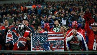 NFL fans watch teams play