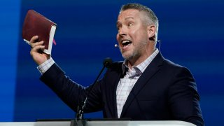 Southern Baptist Convention President J. D. Greear holds a Bible