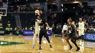 Arike Ogunbowale #24 of the Dallas Wings shoots the game-winning three point basket over Jordin Canada #21 of the Seattle Storm to defeat the Storm 68-67 at Angel of the Winds Arena on June 6, 2021 in Everett, Washington.
