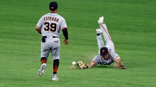 LaMonte Wade Jr #31 of the San Francisco Giants dives for a ball.