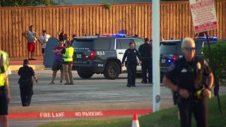 Arlington police say a 16-year-old was shot and killed Wednesday evening near the entrance of Hurricane Harbor water park.