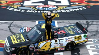 John Hunter Nemechek, driver of the #4 ROMCO Toyota, celebrates after winning the NASCAR Camping World Truck Series SpeedyCash.com 220 at Texas Motor Speedway on June 12, 2021 in Fort Worth, Texas.