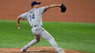Rich Hill #14 of the Tampa Bay Rays pitches in the first inning against the Texas Rangers at Globe Life Field on June 5, 2021 in Arlington, Texas.