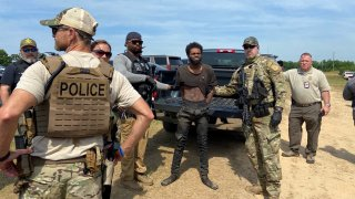 Tyler Terry, a suspect wanted in the killings of multiple people, is arrested in rural Chester County, S.C., on May 24 after a weeklong manhunt ended without a shot fired as hundreds of officers surrounded him.