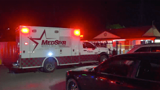 Ambulance at the scene of fatal motel shooting.