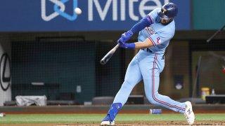 Joey Gallo hitting a baseball with a baseball bat.