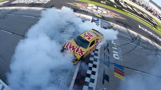 Kyle Busch, driver of the #54 Twix Toyota, celebrates with a burnout after winning the NASCAR Xfinity Series Alsco Uniforms 250 at Texas Motor Speedway on June 12, 2021 in Fort Worth, Texas.