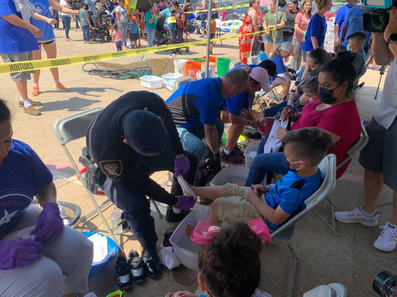 Charity Started By Fort Worth Police Officer Gives Free Shoes to Hundreds of Families