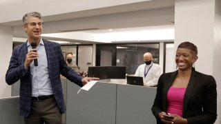 Grant Moise, left, The Dallas Morning News publisher, introduces Katrice Hardy as The News' executive editor, to the newsroom on Wednesday, July 21, 2021, in Dallas, Texas. Hardy, who also will be the first woman to hold the top job at the Dallas newsroom, will take up her duties next month.