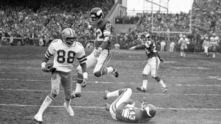 Black and white photo of football players playing football