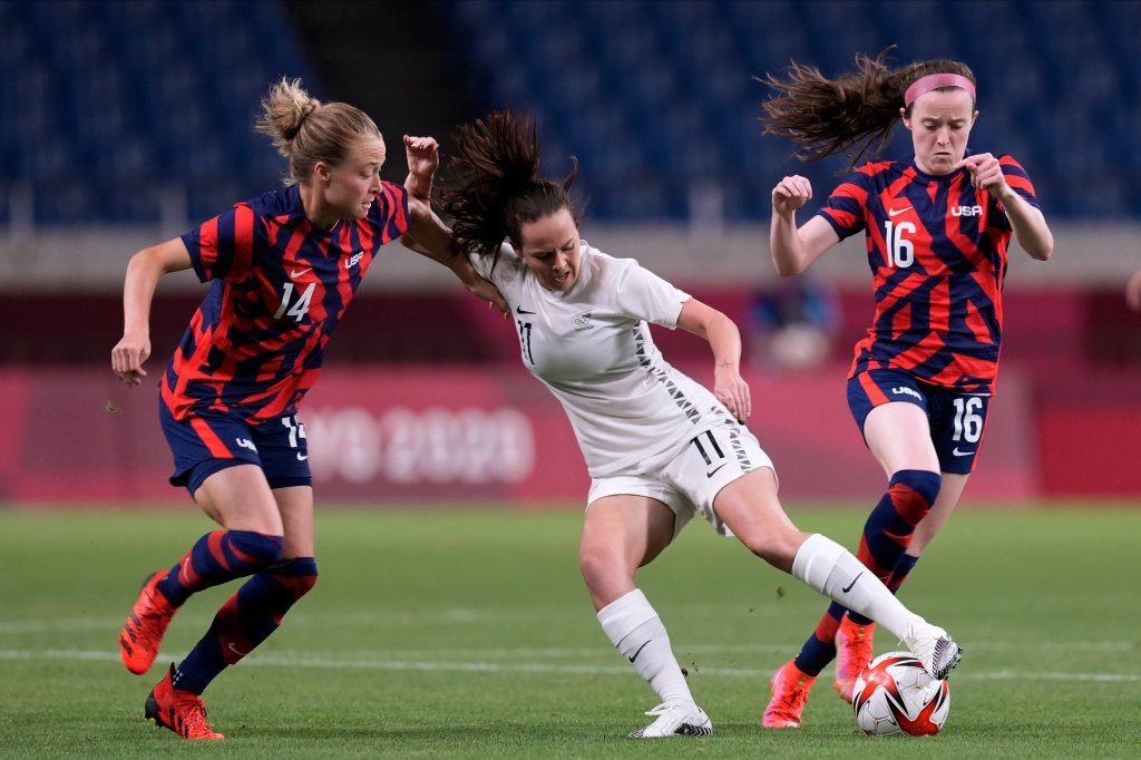 New Zealand's Olivia Chance (11) battles for the shot  against United States' Emily Sonnett (14) and Rose Lavelle (16) during a women's shot    lucifer  astatine  the 2020 Summer Olympics, Saturday, July 24, 2021, successful  Saitama, Japan.